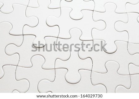 Complete white jigsaw puzzle. - stock photo