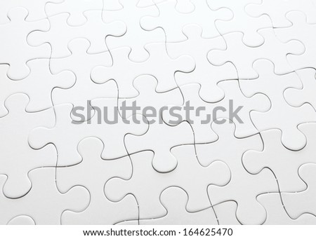 Complete white jigsaw puzzle - stock photo