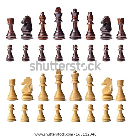 Complete wooden chess set with s full complement of chess pieces in both colours lined up in rows isolated on a white background