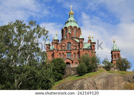 Completed in 1868 in the Katajanokka district of Helsinki, the Uspenski Cathedral is the largest orthodox church in Western Europe. - stock photo