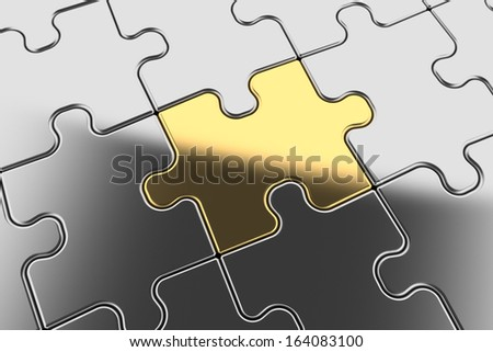 completed puzzle with gold piece - stock photo