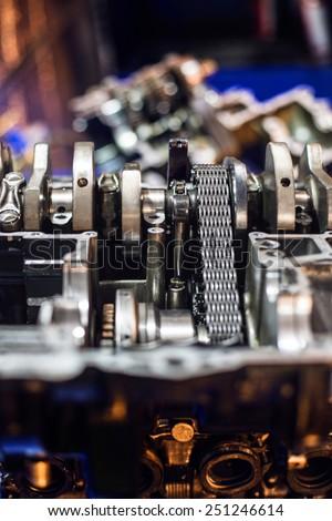 Completely disassembled sport motorcycle engine block crankshaft - stock photo