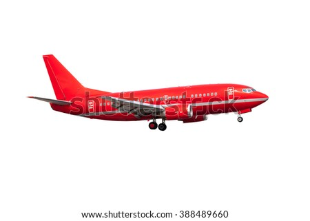 Completely red passenger plane. A side view of aircraft with gear. - stock photo