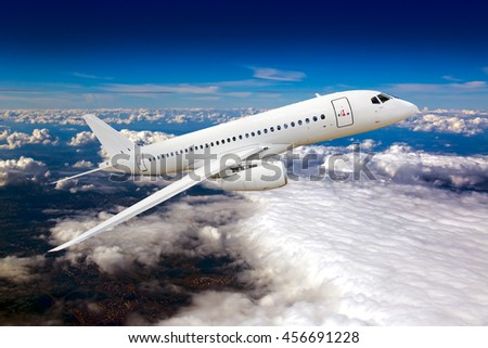 Completely white passenger Jet airplane. Aircraft climbs in the blue cloudy sky. - stock photo