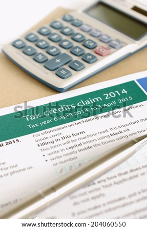 Completing a British tax credit application concept - stock photo