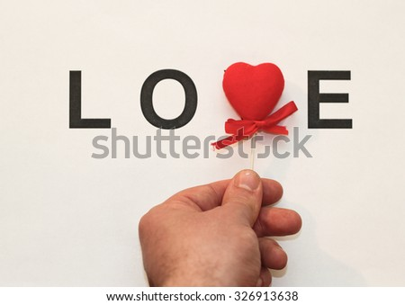 Completing the love with a red heart - stock photo