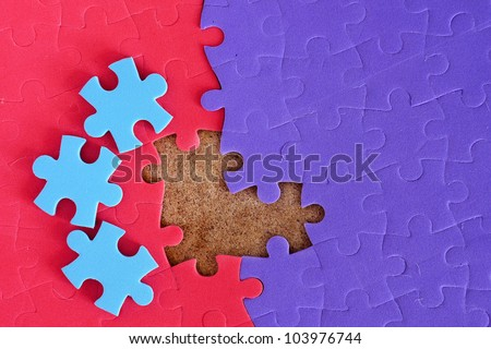 Completing the missing jigsaw puzzle concept - stock photo