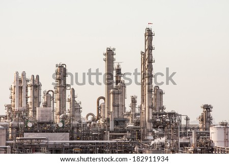 Complex Industrial Building Full of Pipelines - stock photo