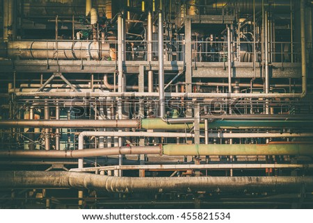 complex network of pipes in a factory filtered image - stock photo