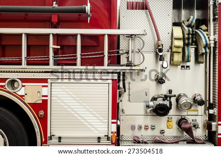 Complex pumping and valve controls on a firetruck - stock photo