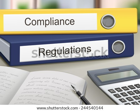 compliance and regulations binders isolated on the office table - stock photo