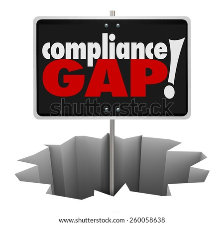 Compliance Gap words on a sign in a hole to illustrate a warning of danger in not following rules, regulations, guidelines and legal requirements - stock photo
