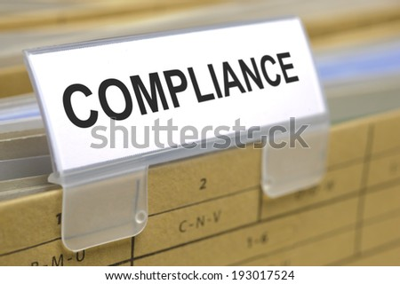 compliance marked on folder - stock photo