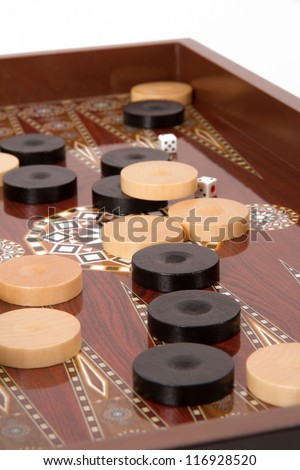 Complicated backgammon chips and dices with six and five. - stock photo