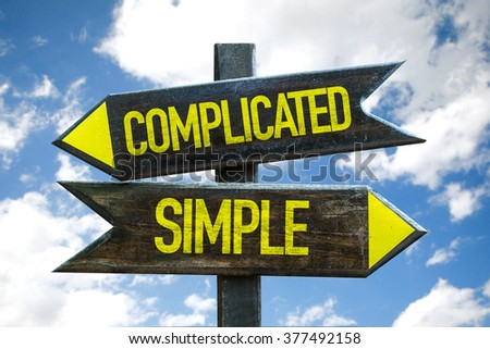 Complicated - Simple signpost with sky background - stock photo