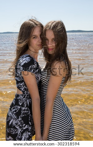 Complicity of two sisters in the summer outside