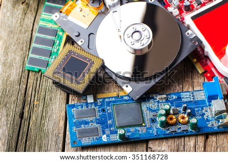 Components for computer over wood desk background - stock photo