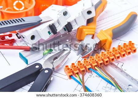 Components for use in electrical installations. Cut pliers, connectors, fuses, knife and wires. Accessories for engineering work, energy concept. - stock photo