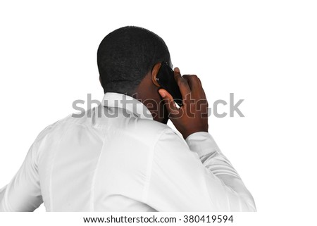 Composed conversation. Black man on the phone. Executive is negotiating. Afroamerican answering cellphone.