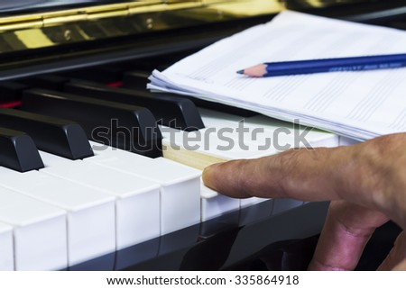 Composer music with Piano and  Record on Staff Paper / Selective focus - stock photo