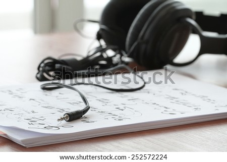 composing music concept with shallow DOF evenly matched jack of headphone and copy space - stock photo