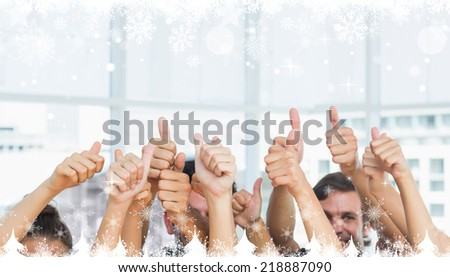 Composite image of a Closeup of cropped people gesturing thumbs up against snow falling - stock photo