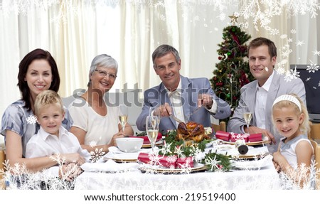Composite image of a Family eating turkey in Christmas Eve Dinner against frost - stock photo