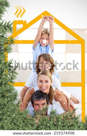 Composite image of a Family having fun with yellow drawing house against twinkling stars - stock photo
