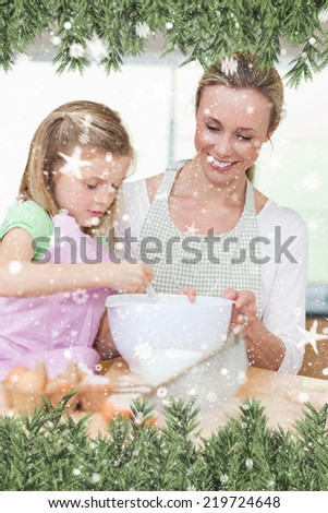 Composite image of a Smiling mother and daughter preparing dough for cookies against snow falling - stock photo