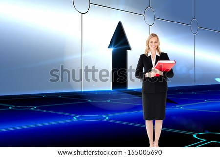 Composite image of attractive blonde businesswoman smiling and holding folders