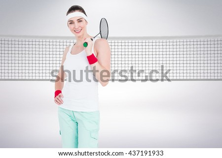 Composite image of badminton player is posing and smiling against white background
