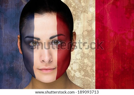 Composite image of beautiful football fan in face paint against france flag in grunge effect