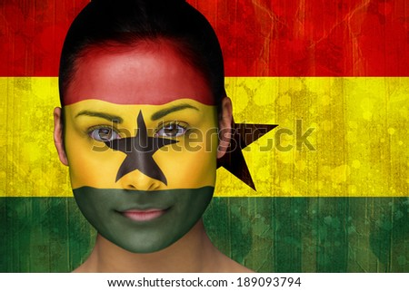 Composite image of beautiful football fan in face paint against ghana flag in grunge effect - stock photo