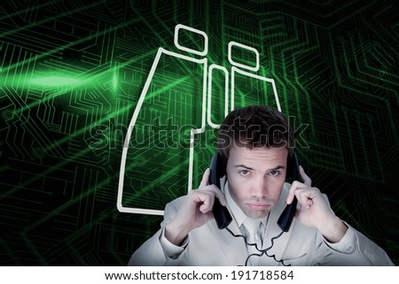 Composite image of binoculars and businessman tangled in wires against green and black circuit board