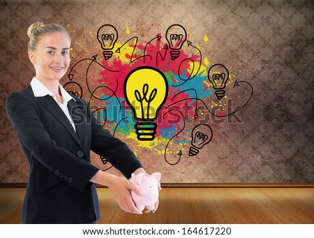 Composite image of blonde businesswoman holding piggy bank - stock photo