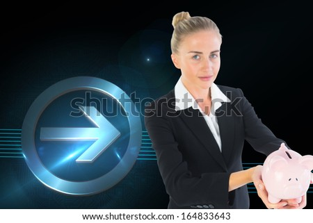 Composite image of blonde businesswoman holding piggy bank
