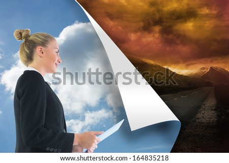 Composite image of blonde businesswoman holding tablet