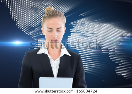 Composite image of blonde businesswoman holding tablet - stock photo