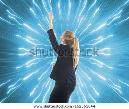 Composite image of blonde businesswoman pulling a chain - stock photo