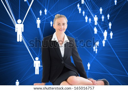 Composite image of blonde young businesswoman sitting on ground