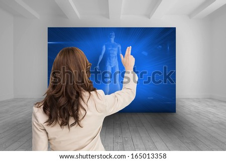 Composite image of brunette businesswoman standing back to camera - stock photo