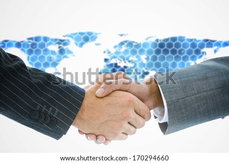 Composite image of business handshake against background with hexagons and world map - stock photo