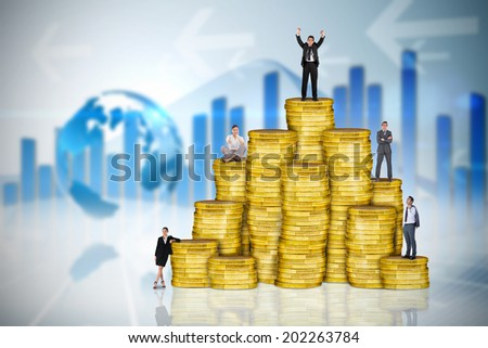 Composite image of business people on pile of coins against global business graphic in blue - stock photo