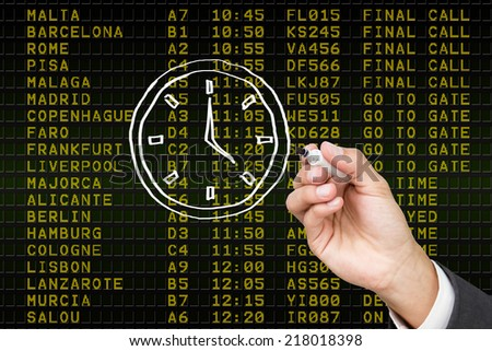 Composite image of business person drawing a white clock - stock photo
