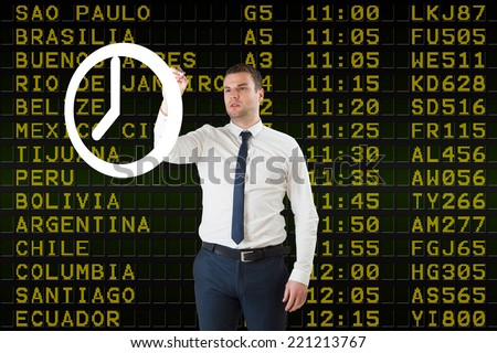 Composite image of business person drawing a white clock against black airport departures board for south america