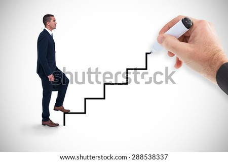 Composite image of businessman climbing