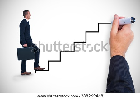 Composite image of businessman climbing with briefcase