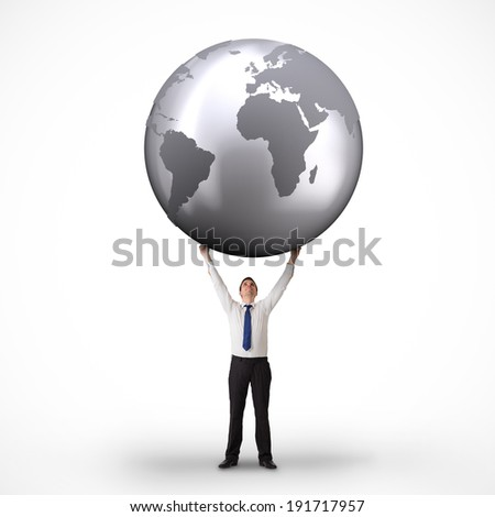 Composite image of businessman holding globe against white background with vignette