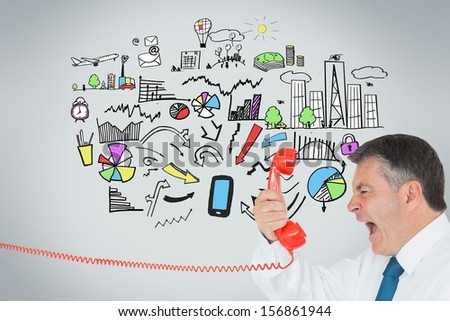 Composite image of businessman screaming directly into the handset in front of economic illustrations on grey background - stock photo