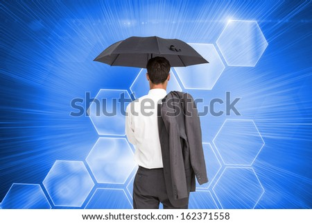 Composite image of businessman standing back to camera holding umbrella and jacket on shoulder - stock photo